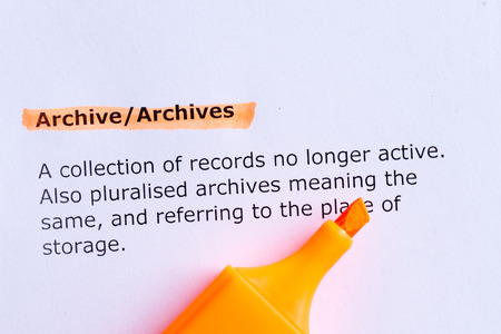 archive  word highlighted  on the white paper photo