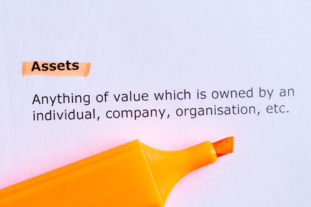 assets  word highlighted  on the white paper photo