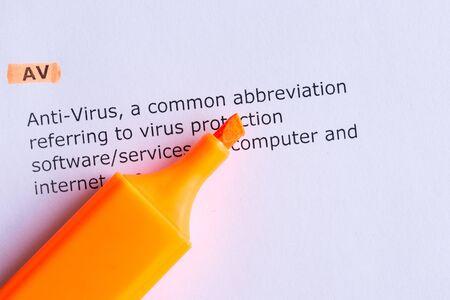 av: av  word highlighted  on the white paper