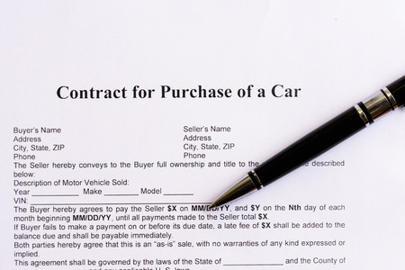 Contract For Purchase Of A Car On The White Paper With Pen – Contract for Selling a Car with Payments