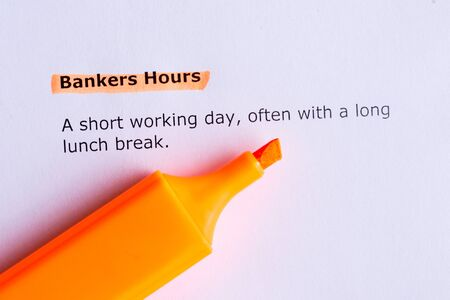 bankers: bankers hours   word highlighted  on the white paper Stock Photo