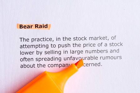 raid: bear raid   word highlighted  on the white paper Stock Photo