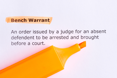 warrant: bench warrant   word highlighted  on the white paper