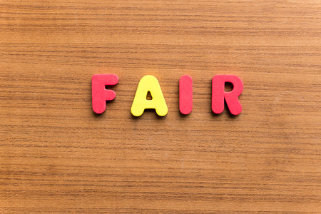 acceptable: fair  colorful word on the wooden background