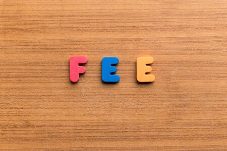 fee: fee  colorful word on the wooden background