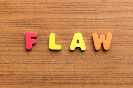 flaw: flaw  colorful word on the wooden background