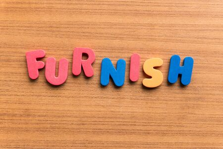 furnish: furnish  colorful word on the wooden background