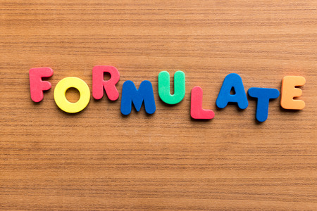 formulate: formulate  colorful word on the wooden background Stock Photo