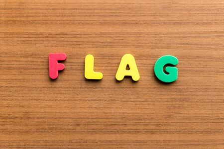 weaken: flag  colorful word on the wooden background Stock Photo