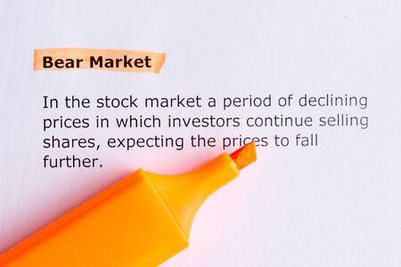 bear market: bear market   word highlighted  on the white paper