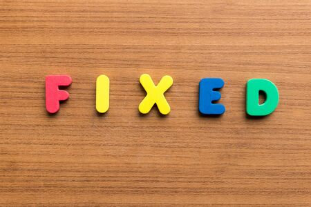 fixed: fixed  colorful word on the wooden background