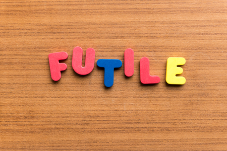 futile: futile colorful word on the wooden background  colorful word on the wooden background Stock Photo