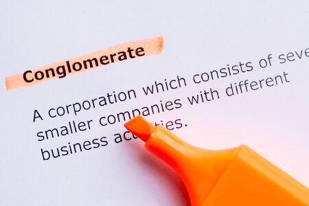 conglomerate: conglomerate  word highlighted in the white backgound