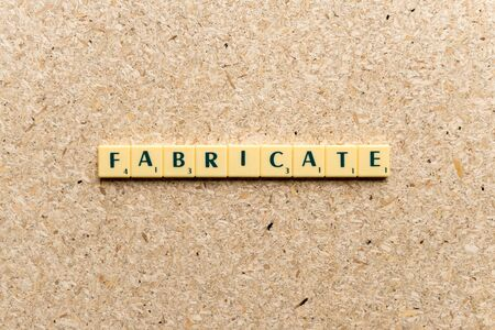 fabricate: fabricate  word on the simple  wooden background