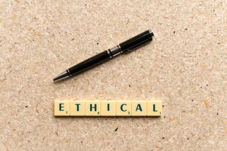 ethical  word on the simple  wooden background