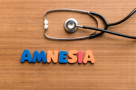 amnesia: Amnesia  colorful word with Stethoscope on wooden background