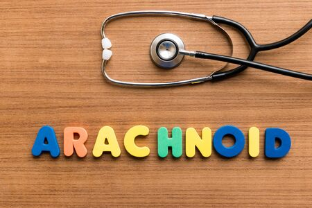 arachnoid: Arachnoid  colorful word with Stethoscope on wooden background
