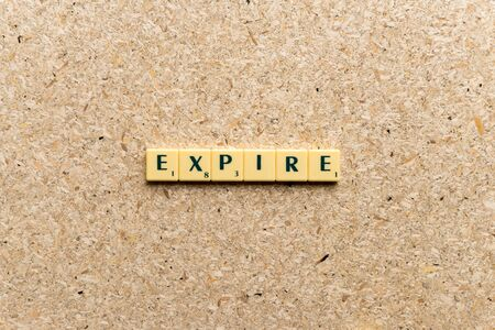 expire: expire  word on the simple  wooden background Stock Photo