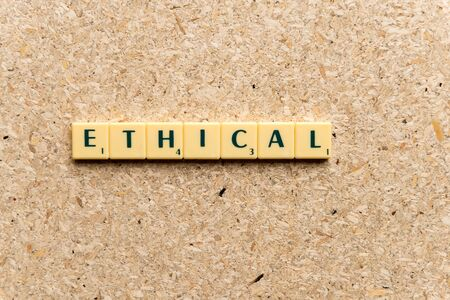 ethical: ethical  word on the simple  wooden background