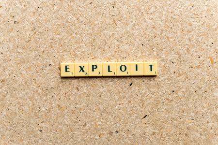 exploit: exploit  word on the simple  wooden background Stock Photo