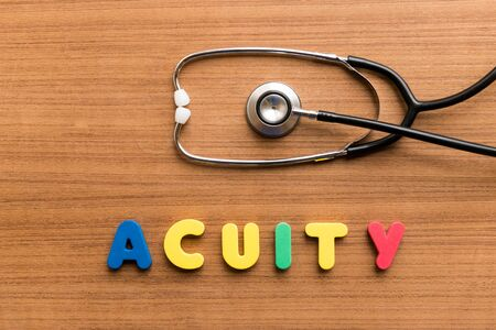 clearness: Acuity  colorful word with Stethoscope on wooden background
