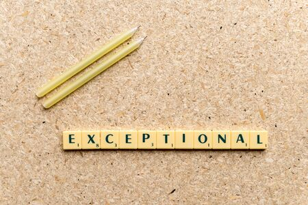 exceptional: exceptional  word on the simple  wooden background