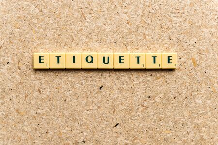 etiquette  word on the simple  wooden background
