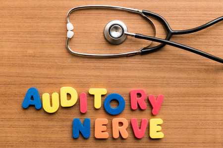 auditory: Auditory nerve   colorful word with Stethoscope on wooden background Stock Photo