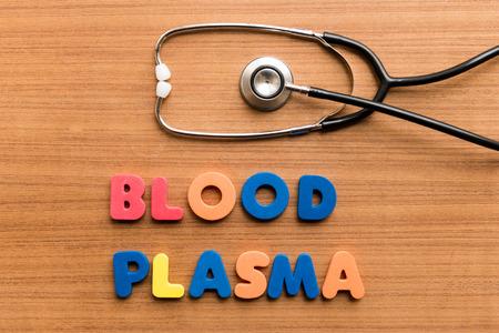 blood plasma: Blood plasma   colorful word with Stethoscope on wooden background Stock Photo