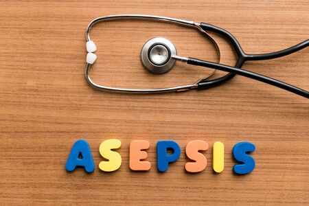 sterility: asepsis  colorful word with Stethoscope on wooden background