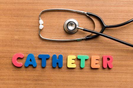 catheter: Catheter   colorful word with Stethoscope on wooden background