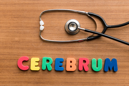 cerebrum: Cerebrum   colorful word with Stethoscope on wooden background