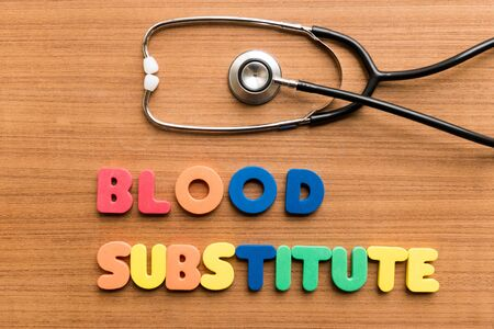 substitute: Blood substitute   colorful word with Stethoscope on wooden background Stock Photo