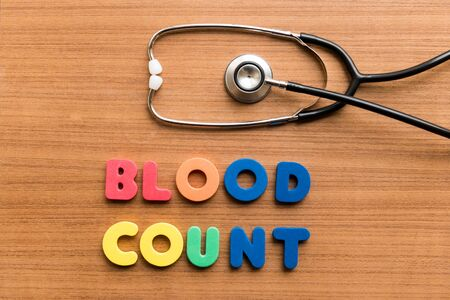 corpuscles: Blood count   colorful word with Stethoscope on wooden background