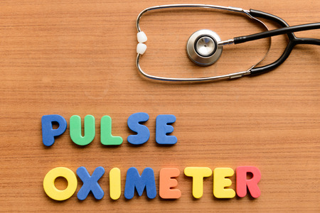 Pulse oximeter  colorful word on the wooden background Stock Photo - 42579237