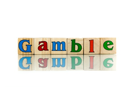fling: gamble colorful wooden word block on the white background