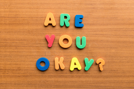 are you okay  colorful words on the wooden background