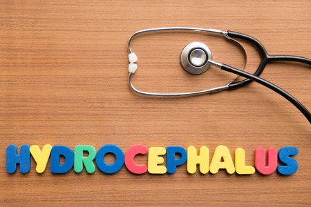 Hydrocephalus colorful word with stethoscope on the wooden background