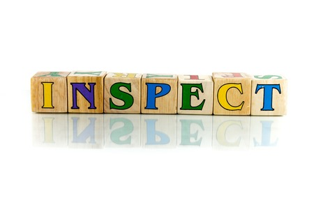 canvass: inspect colorful wooden word block on the white background Stock Photo