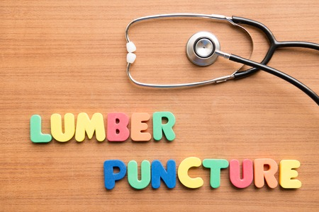puncture: Lumbar puncture (LP)  colorful word with stethoscope on the wooden background
