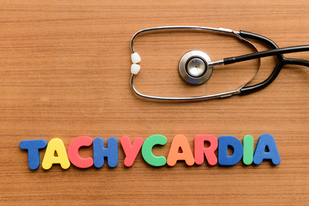 tachycardia: Tachycardia  colorful word on the wooden background