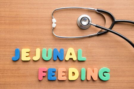 jejunum: Jejunal feeding colorful word with stethoscope on the wooden background