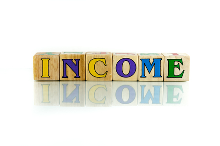honorarium: income colorful wooden word block on the white background Stock Photo
