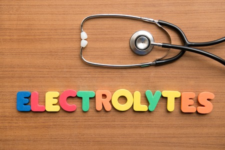 electrolytes: Electrolytes colorful word with stethoscope on the wooden background Stock Photo