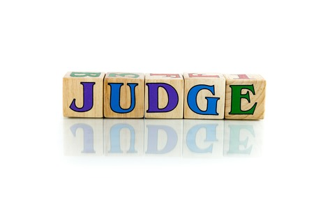 intercessor: judge colorful wooden word block on the white background Stock Photo