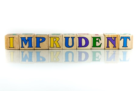 thoughtless: imprudent colorful wooden word block on the white background