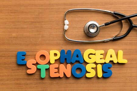 stenosis: esophageal stenosis  colorful medical word and stethoscope on the wooden background