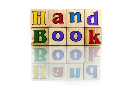 handbooks: handbook colorful wooden word block on the white background