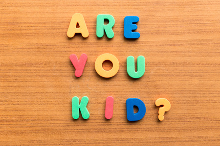 carved letters: are you kid  colorful words on the wooden background