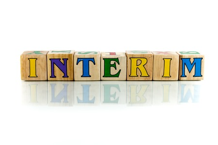 intervening: interim colorful wooden word block on the white background Stock Photo